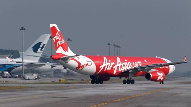Avião da AirAsia: companhia chega à Índia com tarifas baixas Foto: Goh Seng Chong / Goh Seng Chong/Bloomberg