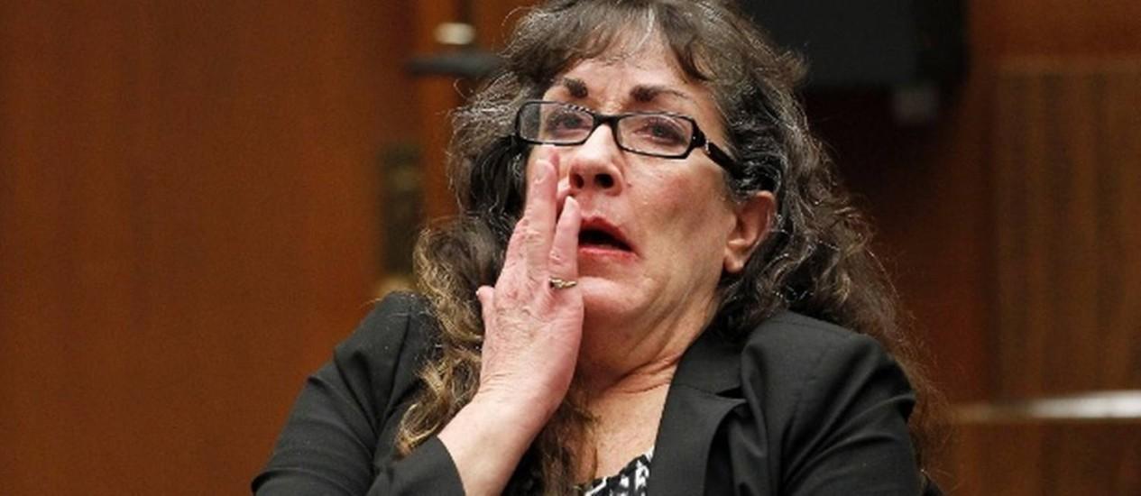 Sherri Lynn Wilkins se emociona ao ouvir a condenação Foto: Nick Ut / AP