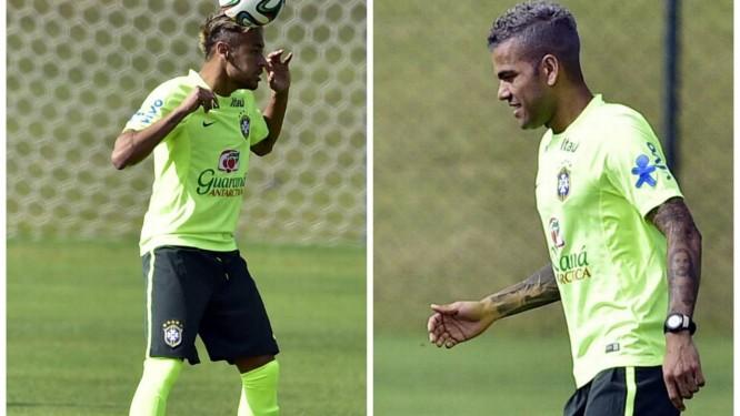 Neymar e Daniel Alves: cabelo novo para a partida contra o México Foto: Gaspar Nóbrega/VIPCOMM