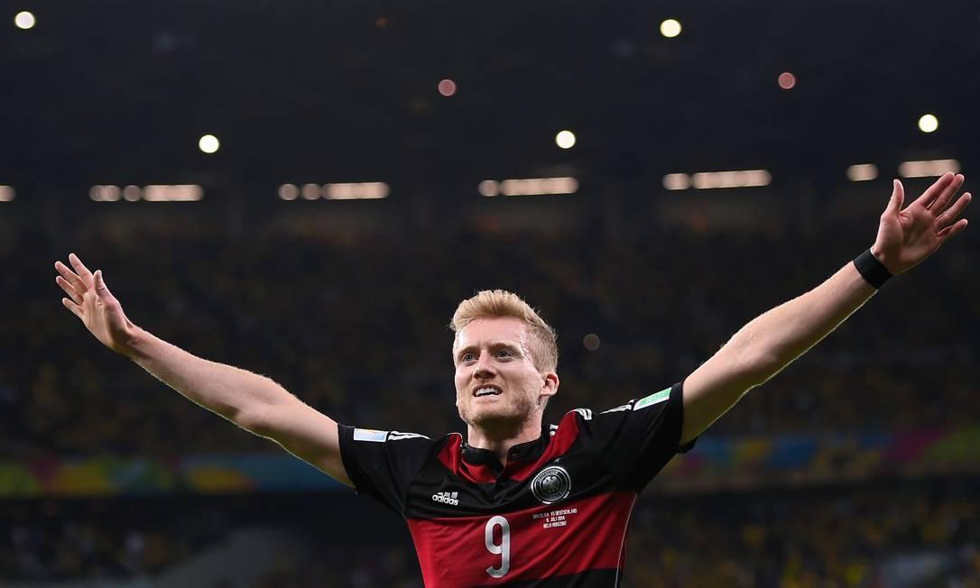 Cinco jogadores vêm a seguir,com 3 gols. Com dois gols sobre o Brasil, o alemão Schuerrle já tem três na Copa FABRICE COFFRINI / AFP