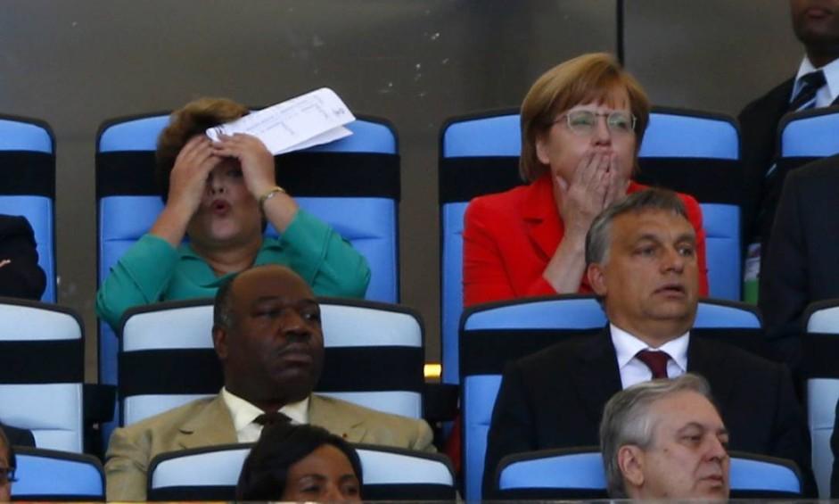 Emoções à flor da pele: a presidente do Brasil, Dilma Rousseff, e a primeira-ministra da Alemanha, Angela Merkel, sofrem com uma jogada perigosa durante a final da Copa, no Maracanã Foto: EDDIE KEOGH / REUTERS