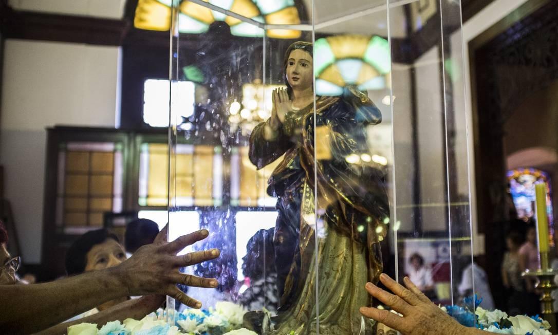 Fieis de Campinas, em São Paulo, também tiveram sua devoção fotografada Foto: Divulgação/ Isabela Senatore