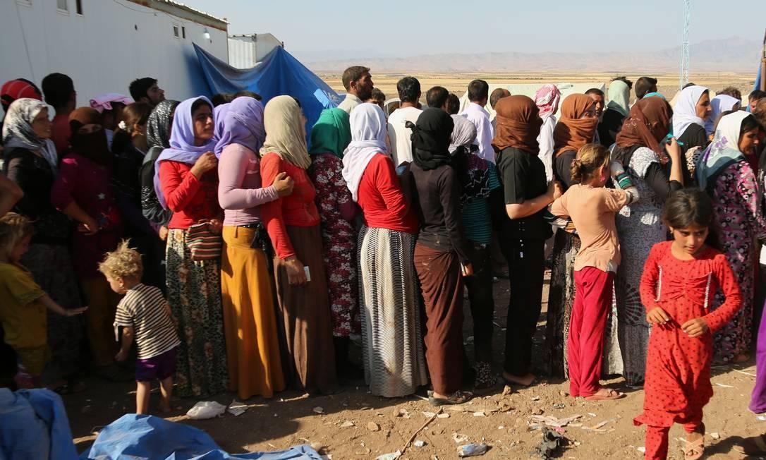 Refugiados yazidis do Iraque, em um acampamento humanitário na Síria Foto: AP