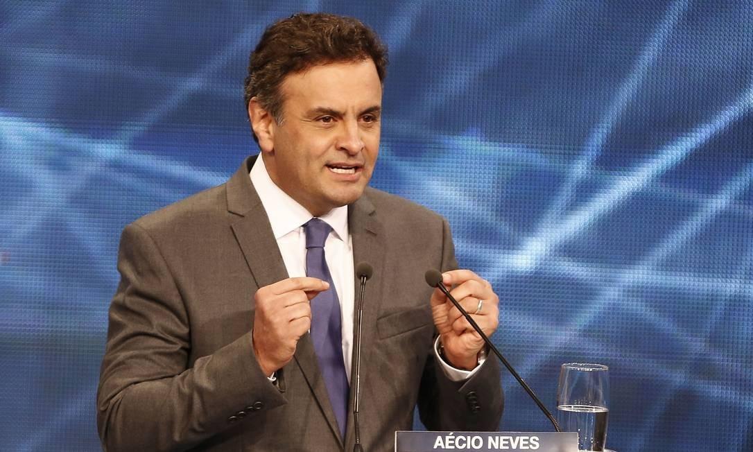 Aécio Neves no debate da Bandeirantes Foto: Miguel Schincariol/AFP / AFP