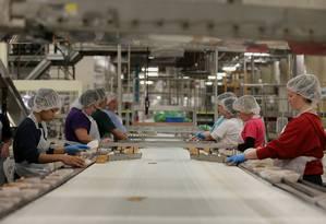 Linha de produção em indústria: setor tem resultado fraco Foto: George Frey / Bloomberg