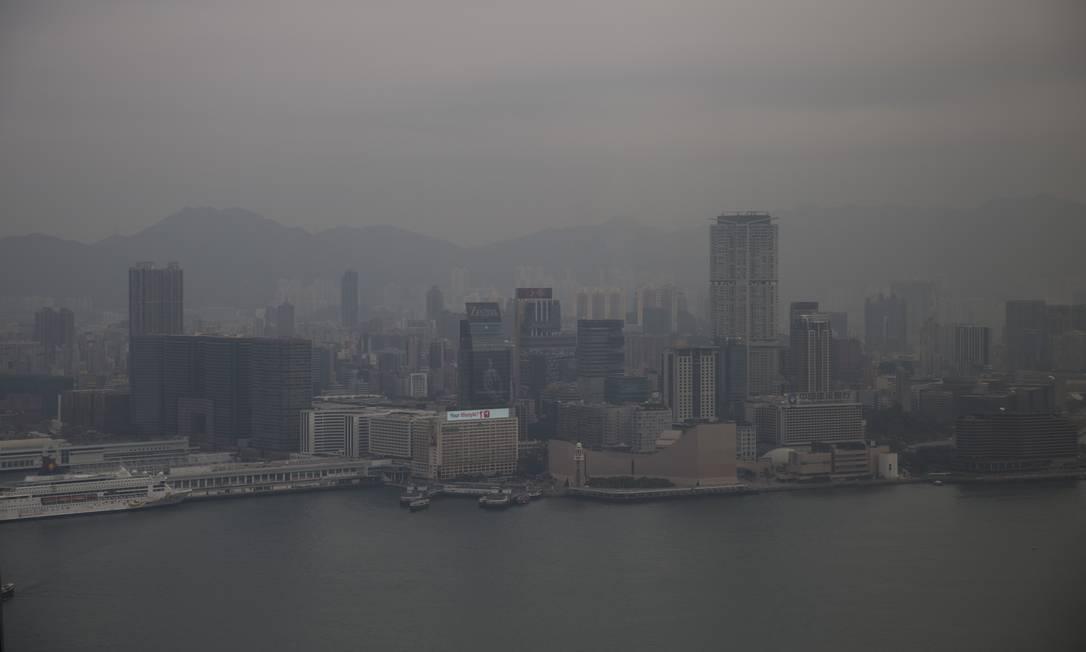 Hong Kong sob a fumaça: em 2013, China respondeu por 28% do total de emissões de gases poluentes na atmosfera, liderando o ranking de países Foto: Brent Lewin / Bloomberg