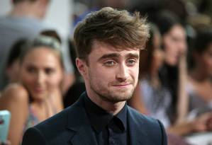 Daniel Radcliffe no tapete vermelho de 'Será que?', em Nova York Foto: AP
