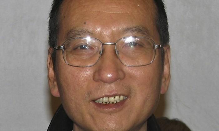 Liu Xiaobo durante um encontro em Pequim Foto: AP