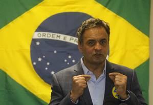 Aécio Neves dá coletiva à imprensa em seu comitê, no Leblon Foto: Fernando Quevedo / O Globo