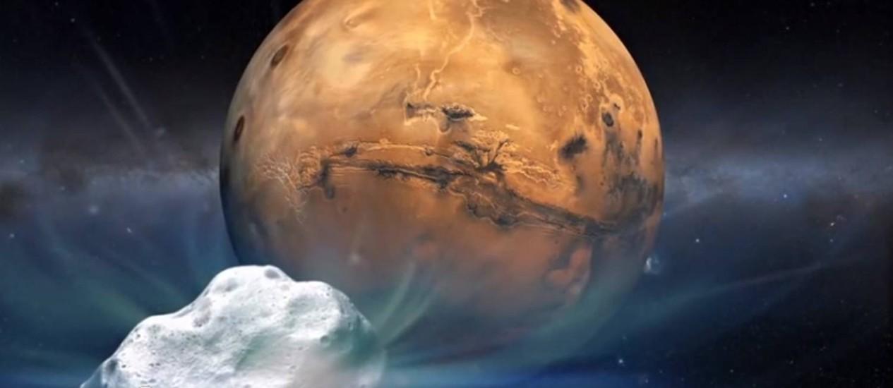 Ilustração de um artista do cometa Siding Spring durante uma passagem próxima a Marte Foto: HO / AFP