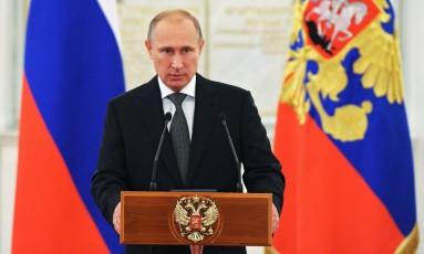 Presidente russo Vladimir Putin durante encontro no Kremlin. Voos de aviões militares russos preocupa Otan Foto: Mikhail Klimentyev / AP