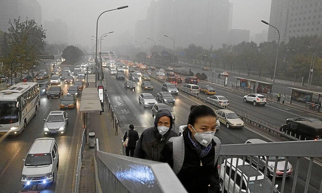 Panorama da poluída Pequim, na manhã de sábado (29/11): ricos querem que emergentes também reduzam emissões Foto: AP/Ng Han Guan