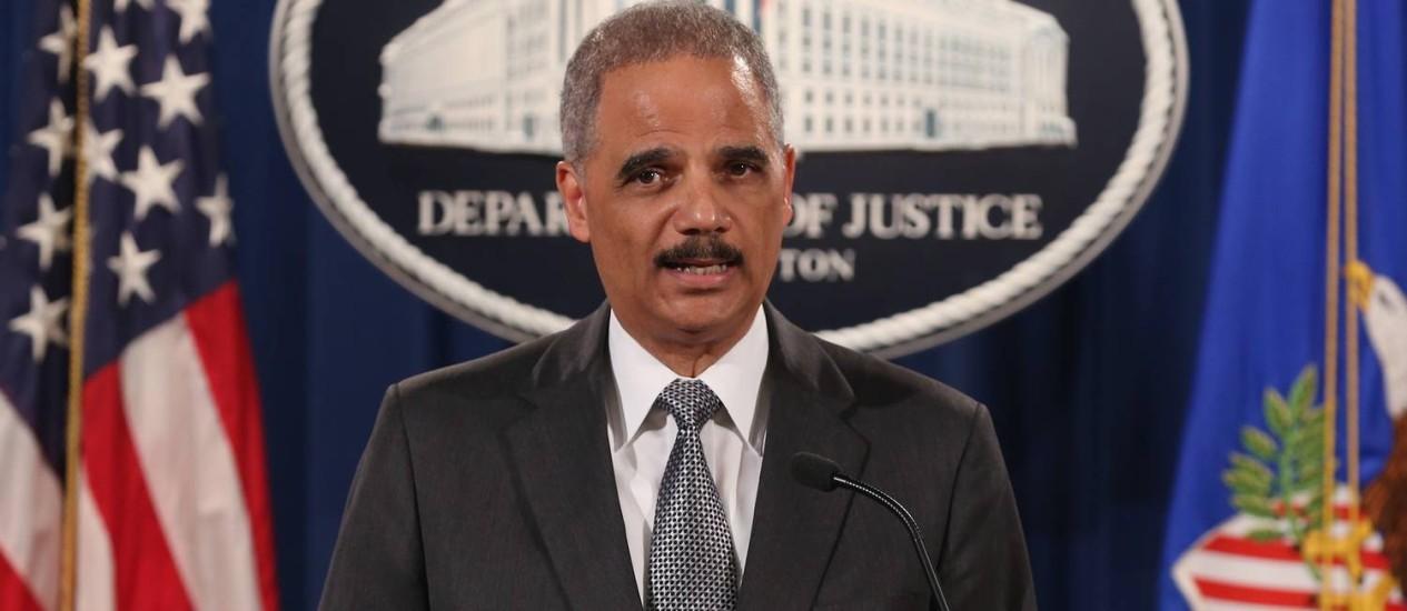 Eric Holder. Procurador geral anunciou plano de reformas no treinamento da polícia de Cleveland Foto: MARK WILSON / AFP