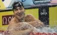Nicholas Santos sorri logo após faturar a prata nos 50m borboleta em Doha