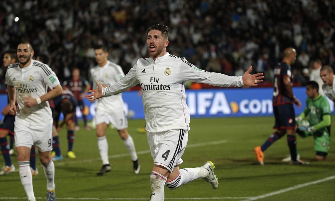 Sergio Ramos corre para comemorar o gol que marcou pelo Real madrid no primeiro tempo da decisão contra o San Lorenzo, no Marrocos Foto: Christophe Ena / AP