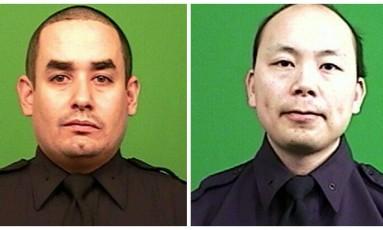A polícia de Nova York divulgou fotos de Rafael Ramos (à esq.) e Wenjian Liu, os dois policiais mortos no Brooklyn na noite de sábado Foto: AP Photo/New York Police Department