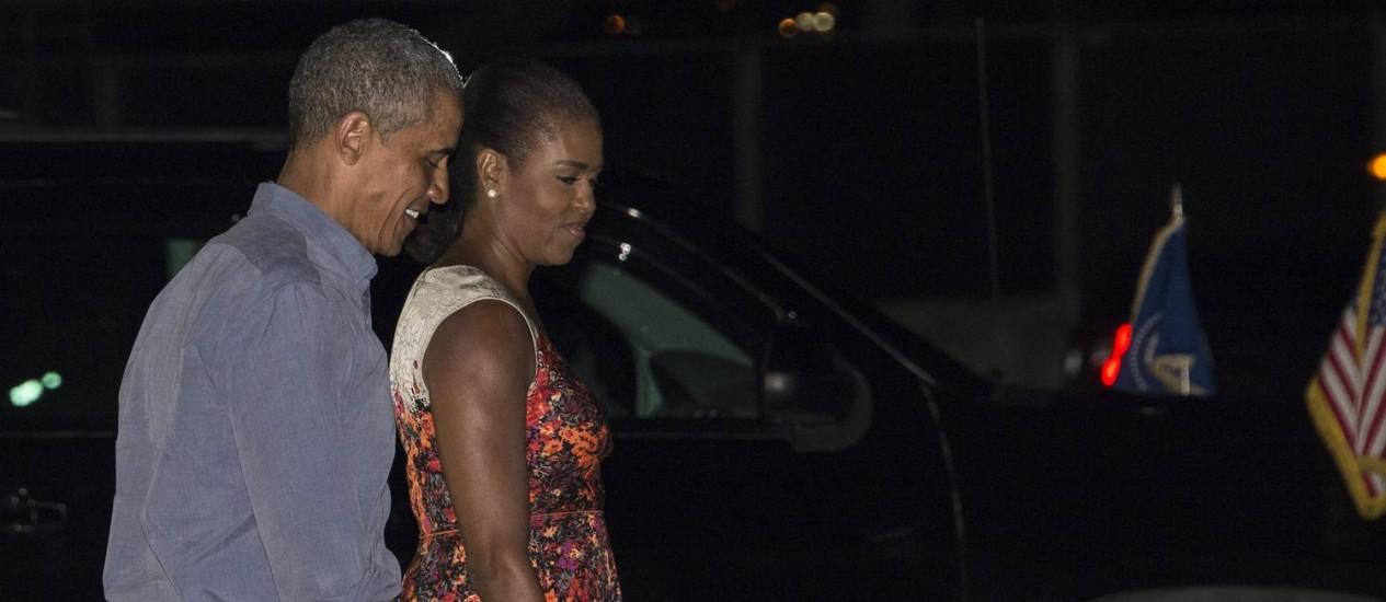 Barack e Michelle Obama em Honolulu Foto: NICHOLAS KAMM / AFP