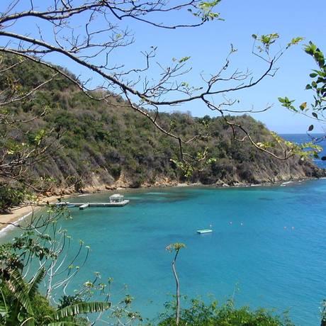 Blue Waters Bay, uma das praias preservadas da ilha de Tobago, no Caribe, novo destino da Gol Foto: Divulgação