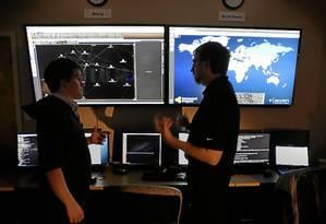 Ameaça local e mundial. Pesquisadores de pragas virtuais da divisão de segurança digital da Dell mapeiam a disseminação de vírus de computador por hackers em diversos países Foto: Stephen Morton/Bloomberg / Bloomberg