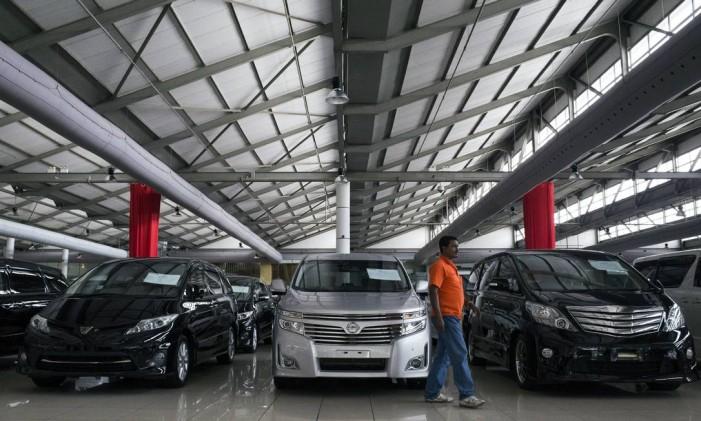 Concessionária de automóveis na Malásia Foto: Joshua Paul / AP