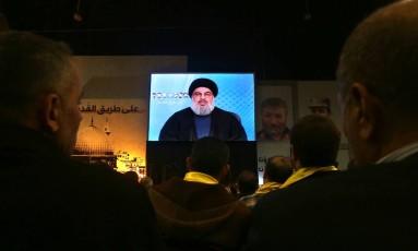 Nasrallahfala com seguidores do Hezbollah, em conferência em Beirute Foto: Bilal Hussein / AP