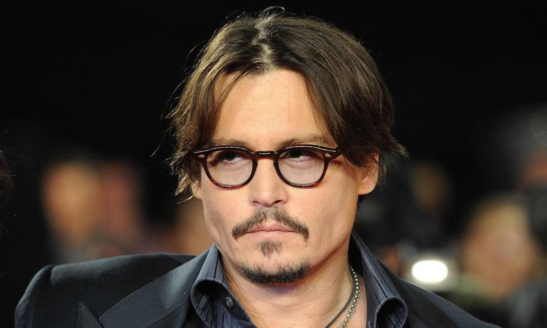 Johnny Depp virá tocar guitarra no Rio Foto: PAUL HACKETT / Reuters