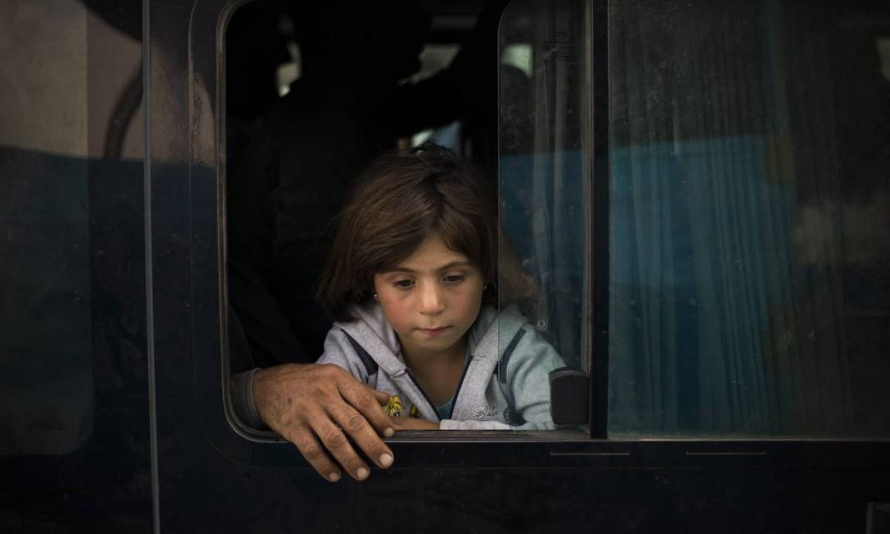 Menina de Kobani cruza o Iraque após passar pela Turquia: fronteira foi aberta para ajudar fluxo de curdos na região Foto: Dominic Nahr / UNHCR / D. Nahr