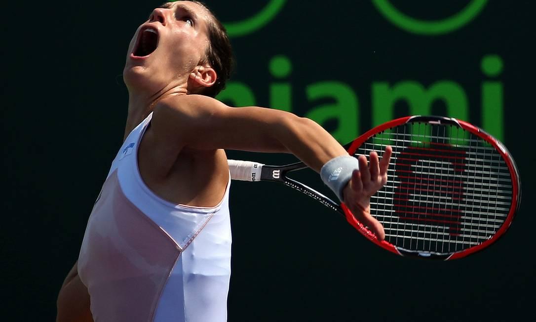 A concentração da alemã Andrea Petkovic nesta segunda-feira, em Miami Mike Ehrmann / AFP