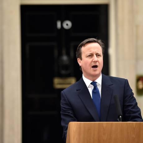 """Governo. O primeiro-ministro David Cameron busca reeleição afirmando que opositor trabalhista levaria o país ao """"caos econômico"""" Foto: LEON NEAL/AFP"""