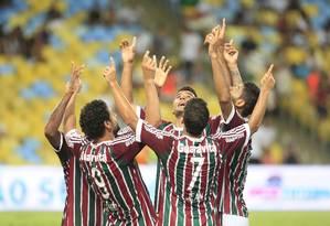 Jogadores do Flu festejam: time inverteu a vantagem que era do Botafogo na semifinal Foto: Nina Lima / Agência O Globo