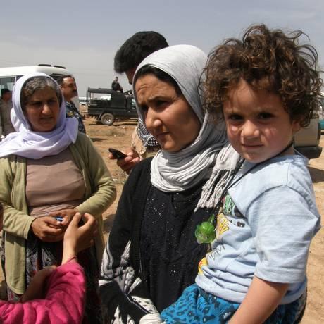 Yazidis libertados pelo Estado Islâmico chegam a Kirkuk, no Iraque Foto: Uncredited / AP