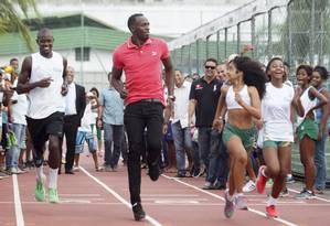 ES - Rio de Janeiro - 16/04/2015 - Usain Bolt visita a Vila Olímpica da Mangueira . Foto: Marcelo Carnaval/ Agência O Globo Foto: Marcelo Carnaval / Agência O Globo