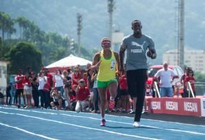 Usain Bolt participa de ação de marketing do Mano a Mano, atuando como guia da velocista paralímpica brasileira Terezinha Guilhermina Foto: Victor Eleuterio / Divulgação