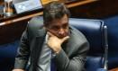 O senador Aécio Neves diz que PSDB só avançará para impeachment de Dilma quando tiver 'certeza' de crimes Foto: André Coelho / Agência O Globo