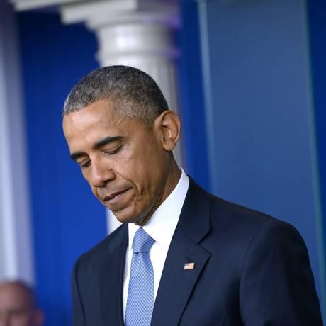 Presidente americano, Barack Obama, expressa condolências aos familiares dos dois reféns da al-Qaeda mortos acidentalmente em uma operação militar americana na fronteira entre o Afeganistão e Paquistão Foto: MANDEL NGAN / AFP
