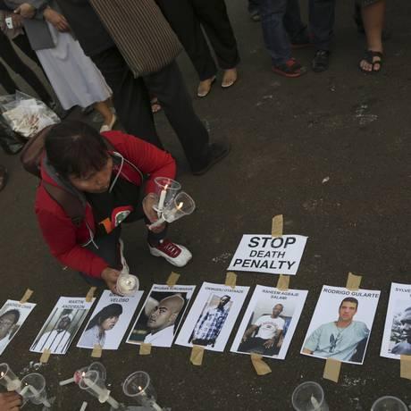 Ativista indonésia protesta contra os fuzilamentos Foto: Achmad Ibrahim / AP
