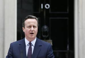 Cameron fala diante da residência do primeiro-ministro, no número 10 de Downing Street Foto: STEFAN WERMUTH / REUTERS