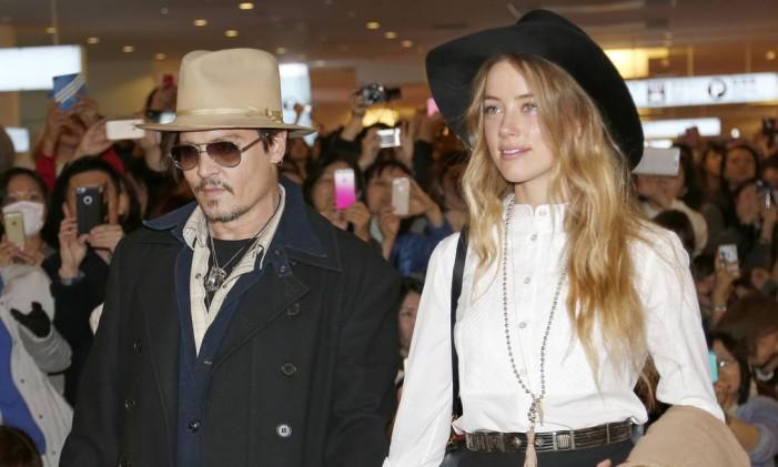 Johnny Depp e a mulher Amber Heard Foto: Shizuo Kambayashi / AP