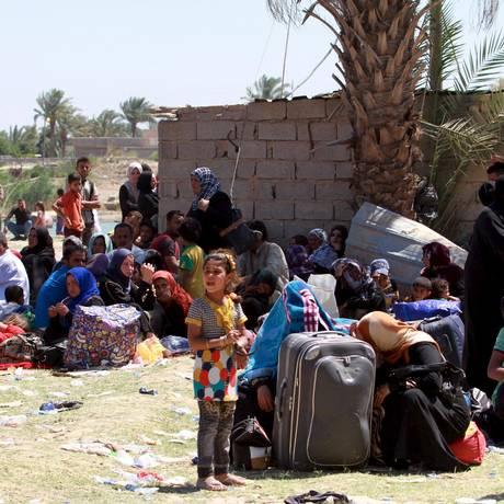 Sunitas fogem da violência em Ramadi e chegam a Bagdá Foto: STRINGER/IRAQ / REUTERS
