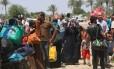 Iraquianos fogem de Ramadi após captura da cidade por extremistas do Estado Islâmico