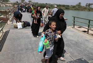 Mais de 40 mil iraquianos fugiram de Ramadi, e êxodo continua com entrada do Estado Islâmico Foto: Karim Kadim / AP