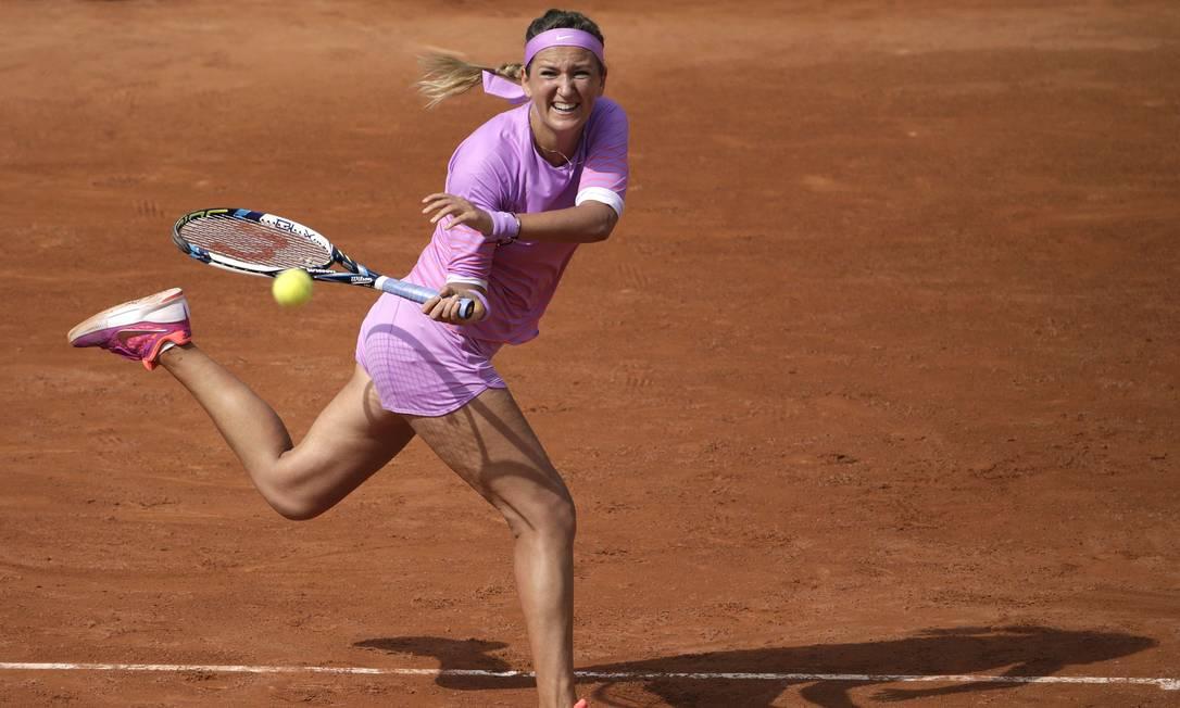 EEla teve que enfrentar a bielorrussa Viktoria Azarenka, que acabou vencendo a partida por 2 sets a 0 KENZO TRIBOUILLARD / AFP