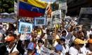 Liberdade. Vestidos de branco, milhares de manifestantes foram às ruas de Caracas contra o governo do presidente Nicolás Maduro Foto: CARLOS GARCIA RAWLINS/ REUTERS