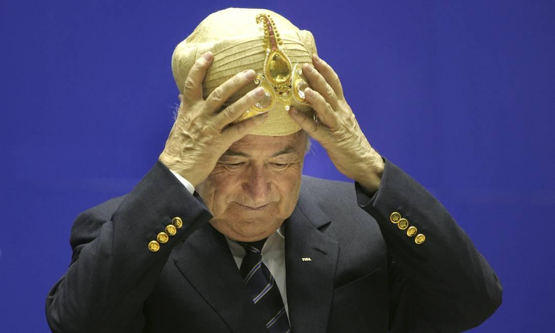 Em abril de 2007, com chapéu típico da Índia, na festa de 70 anos da federação de Futebol do país Manish Swarup / AP