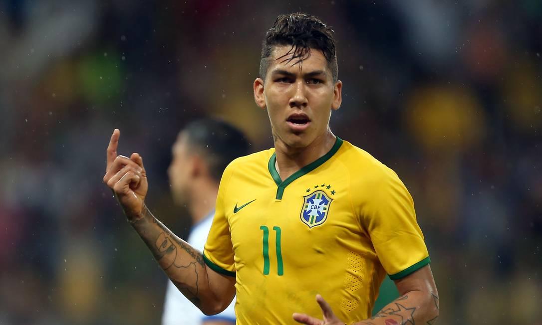Firmino abriu o placar para o Brasil no Beira-Rio JEFFERSON BERNARDES / AFP