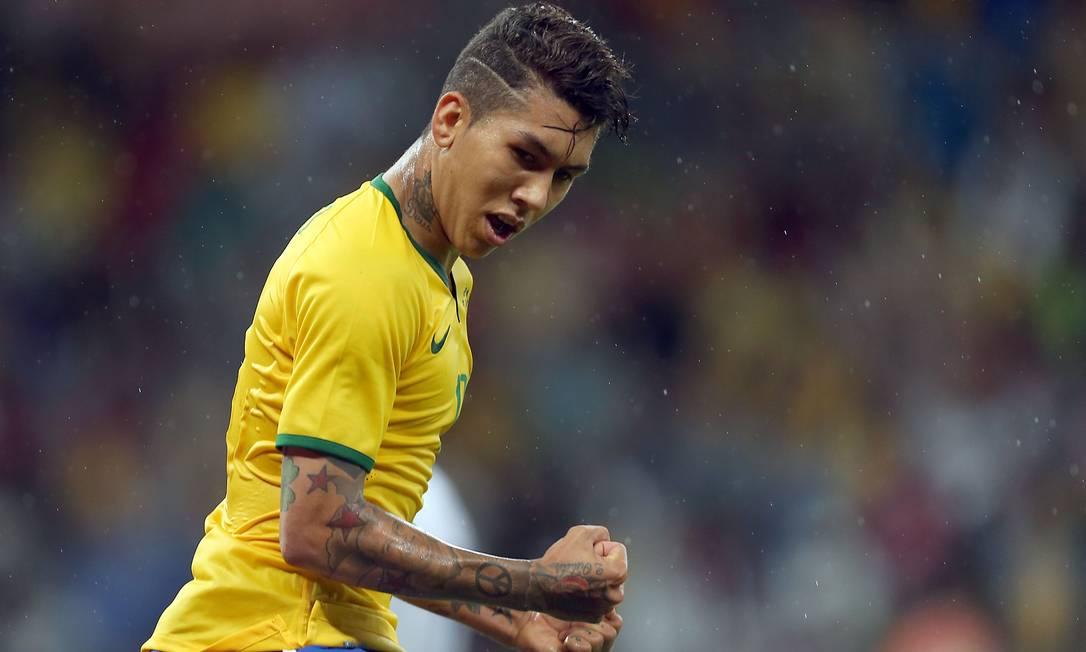 Firmino comemora o primeiro gol do Brasil JEFFERSON BERNARDES / AFP