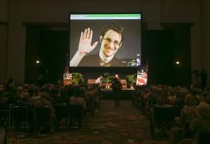 Snowden participa de videoconferência em Moscou Foto: Marco Garcia/AP/14-2-2015
