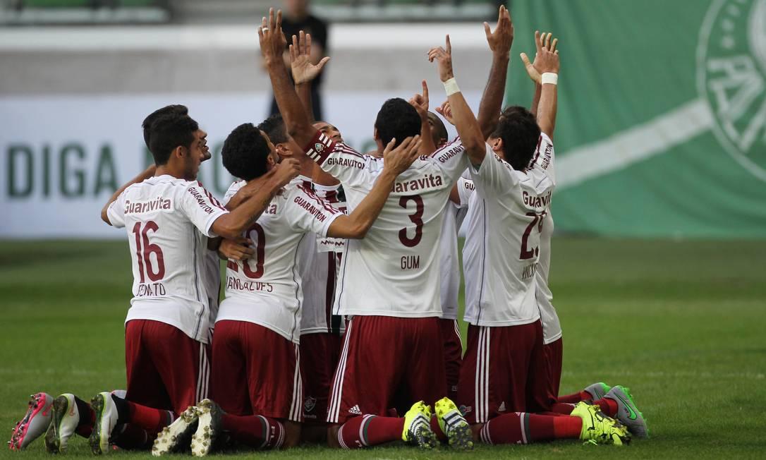 Jogadores do Fluminense comemoram o gol de Jean sobre o Palmeiras Michel Filho / Agência O Globo