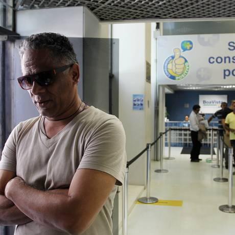 Juan Aguiler, na sede do SPC, em São Paulo, onde foi renegociar suas dívidas. Após falência de empresa, dívida de R$ 40 mil Foto: Michel Filho / Michel Filho