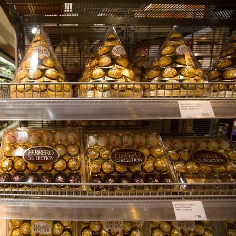 A customer shops near a display of Ferrero Rocher chocolates inside an Azbuka Vkusa OOO, which translates as